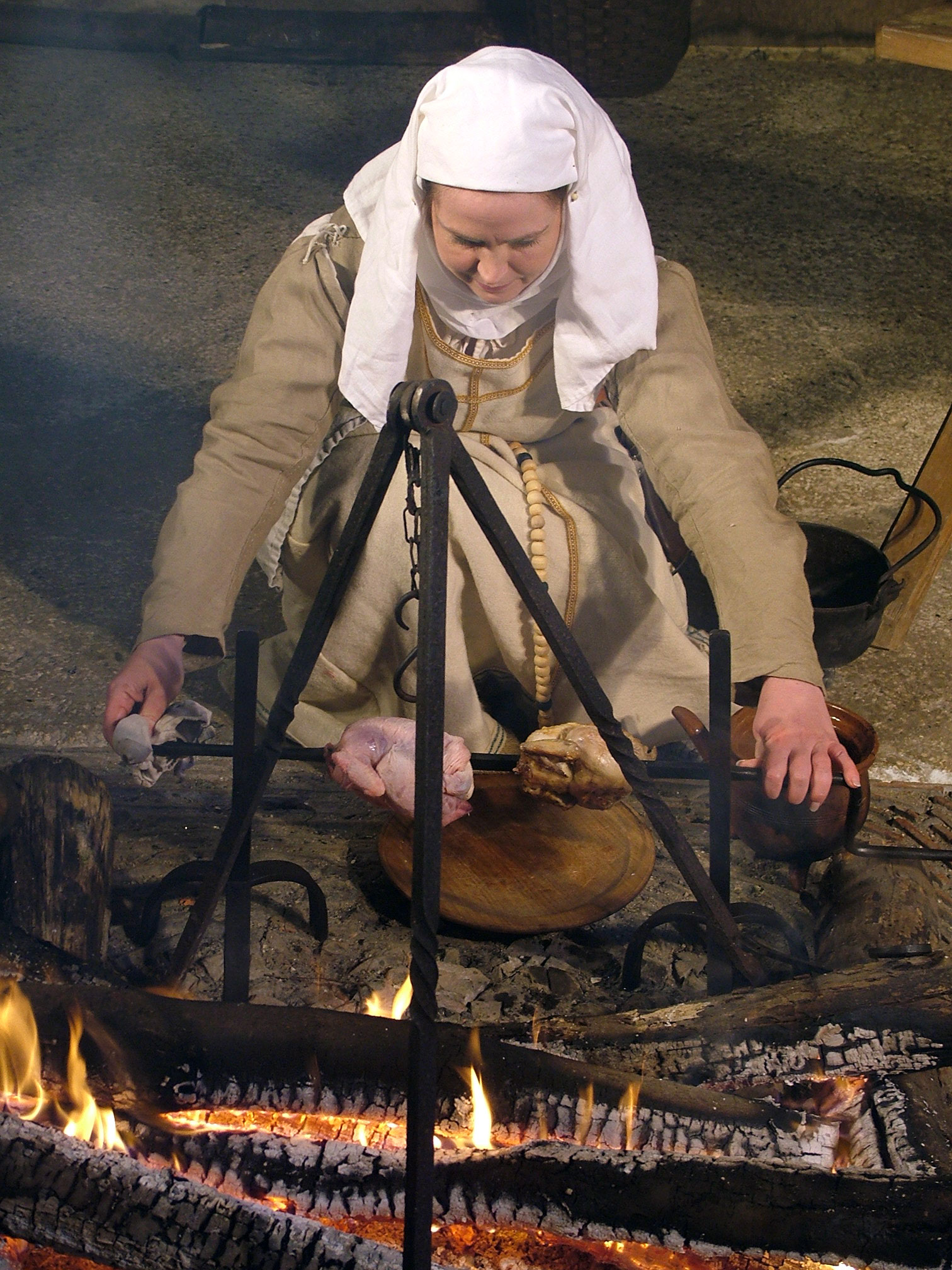 Roasting Chickens the medieval way © Diane Earl